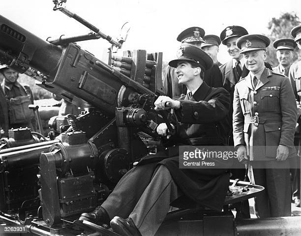 King Peter II King of Yugoslavia from 1934 1945 at the controls of a Borfers gun at an AA gun site in the company of Sir Frederick Pile the commander...