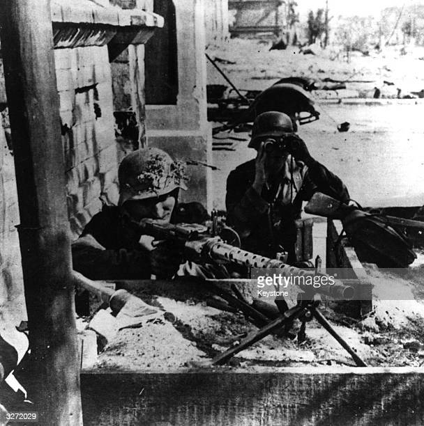The advancing Nazi invaders shelter behind their barricades fortified with machine guns in the streets of Stalingrad which they have occupied