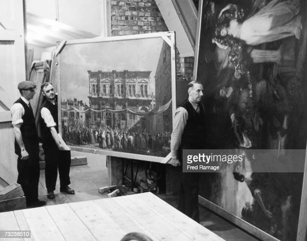 A painting is taken out of storage for routine inspection at an underground facility at Manod Quarry north Wales where paintings from the National...
