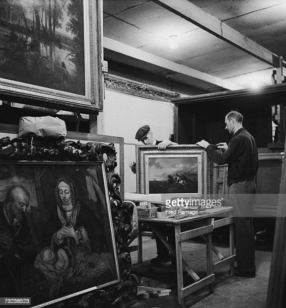 A picture frame being repaired in a subterranean chamber at Manod Quarry north Wales where paintings from the National Gallery have been moved for...