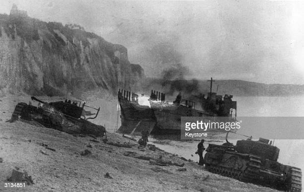 According to German wartime sources this is a British tank landing vessel and two British tanks captured by the Germans during the raid on Dieppe