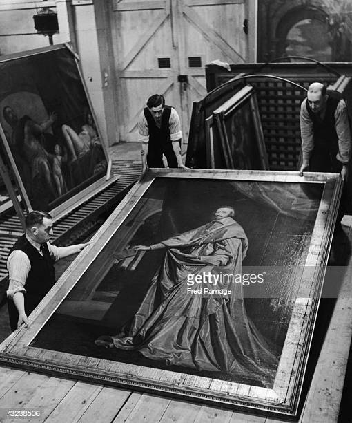 Attendants take 'Cardinal Richelieu' by Philippe de Champaigne out of storage for routine inspection in an underground facility at Manod Quarry north...