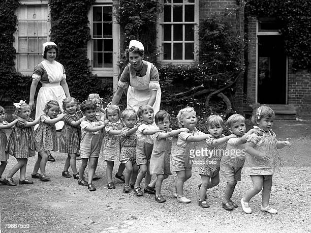 September 1942 Children playing trains with nurses in the grounds of Eichelford House in Hertfordshire the home of Mrs Randolph Churchill used as a...