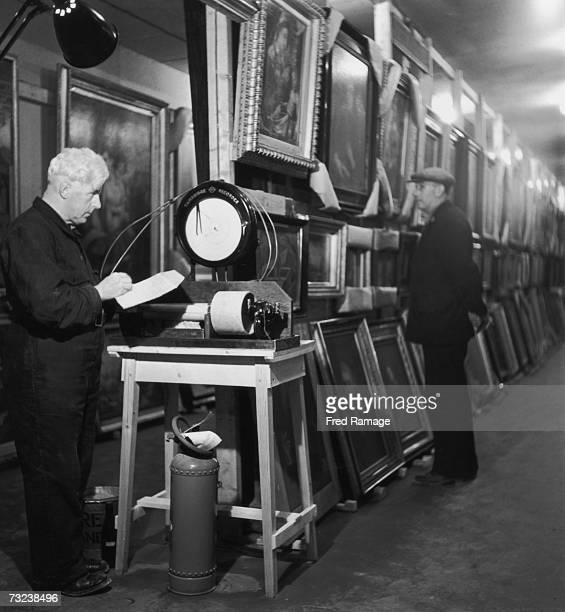 Engineer in charge JR Jones takes a reading of the relative humidity in a subterranean chamber at Manod Quarry north Wales where paintings from the...