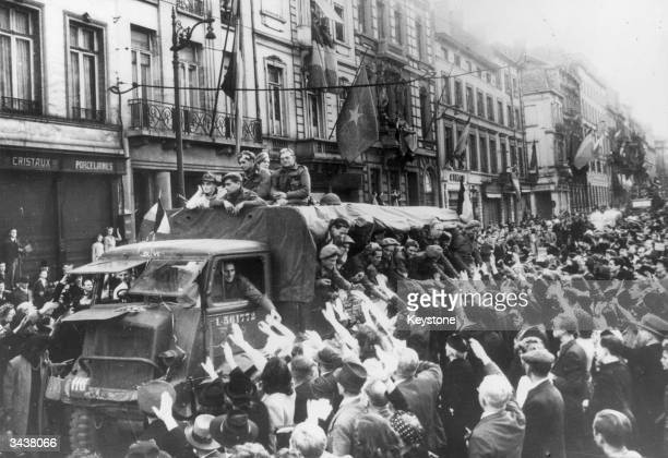A Belgian Brigade is welcomed by hundreds of people as they drive down the Rue Royale Brussels during the liberation of the city by Allied forces