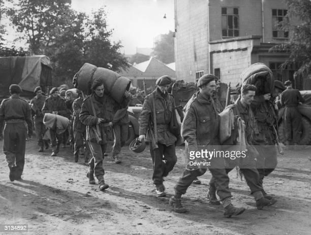 Group of British soldiers, survivors of the Battle of Arnhem during World War II, reach the relative safety of Belgium. 10,000 British servicemen...