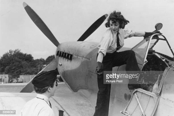 A woman of the Air Transport Auxiliary climbs into the cockpit of a spitfire Original Publication Picture Post 1944 Work Of The Ferry Pilots pub 1944