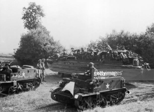 Bren gun carriers and 'ducks' carrying British Troops advancing to liberate Eindhoven