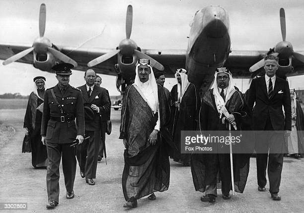 Colonel The Lord Manners, , next to Emir Faisal ibn Abdul Aziz of Saudi Arabia, at Herne Airport, Hampshire. Also in the group are Emir Mohamed, Emir...