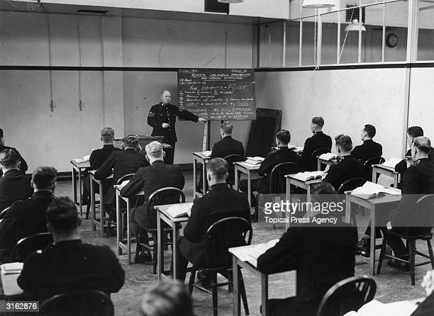 A class of police recruits learn how to deal with riots and unlawful demonstrations at the Police Training School in Hendon London