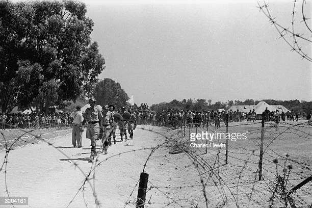 British troops and Jewish immigrants at the camp near Famagusta Cyprus where Jewish refugees are being kept having been turned away from Palestine...