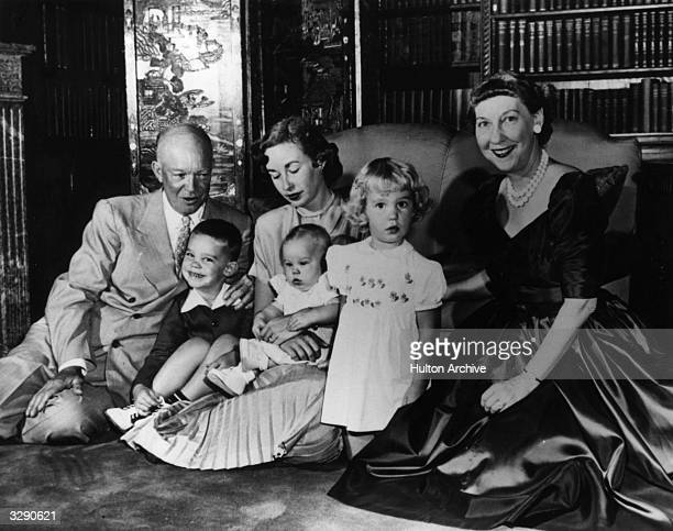 The 34th American President Dwight D Eisenhower with his family before the election By his side are his grandson Dwight David II his daughterinlaw...