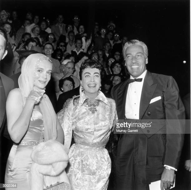 EXCLUSIVE LR American actors Marie Wilson Joan Crawford and Cesar Romero pose together at the premiere of director George Cukor's film 'A Star Is...