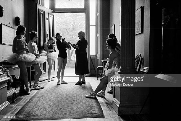 Dance teacher Marjorie Middleton talking to her students while they relax between classes at the Scottish Ballet School at Grosvenor Crescent...
