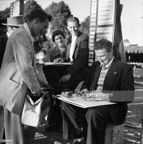 A bookie pays out at the Inter Dominion Trotting Championships at Sydney Racecourse