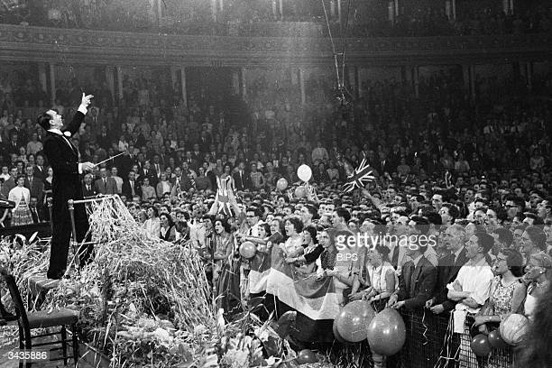 British fans at the Royal Albert Hall in London for the 49th Symphony Concert conducted by Malcolm Sargent