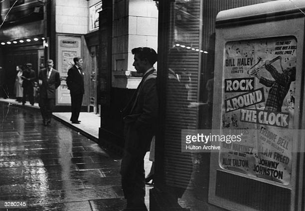 'Rock Around The Clock' the film which sparked off riots in London and provincial cinemas advertised on a billboard outside a cinema