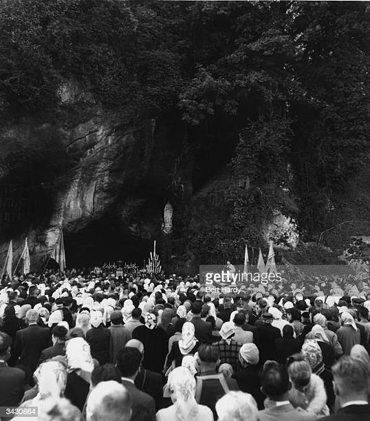 Pilgrims attending a service at Lourdes in France