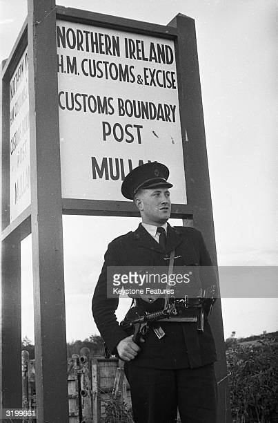 A member of the Royal Ulster Constabulary stands guard at a customs boundary post in Northern Ireland