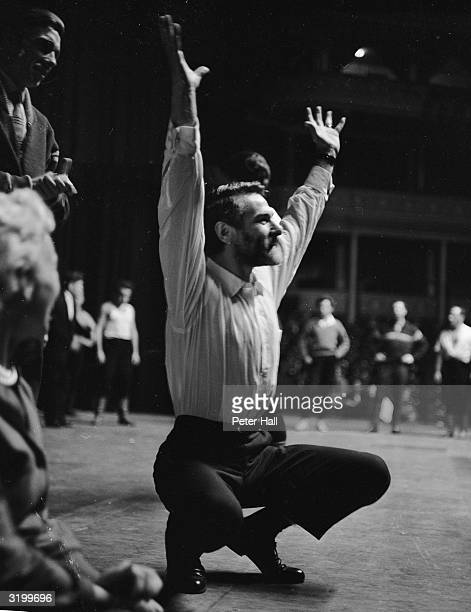 Actor Sam Wanamaker taking lessons in cossack dancing from Ukrainian State Dancers at the Albert Hall in London He is required to perform the...