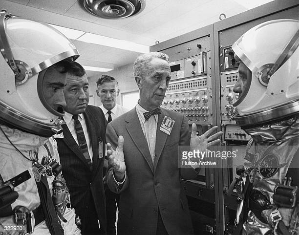 American artist Norman Rockwell talks to astronauts John W Young and Virgil I. Grissom , the pilots selected to fly the first manned Gemini orbital...
