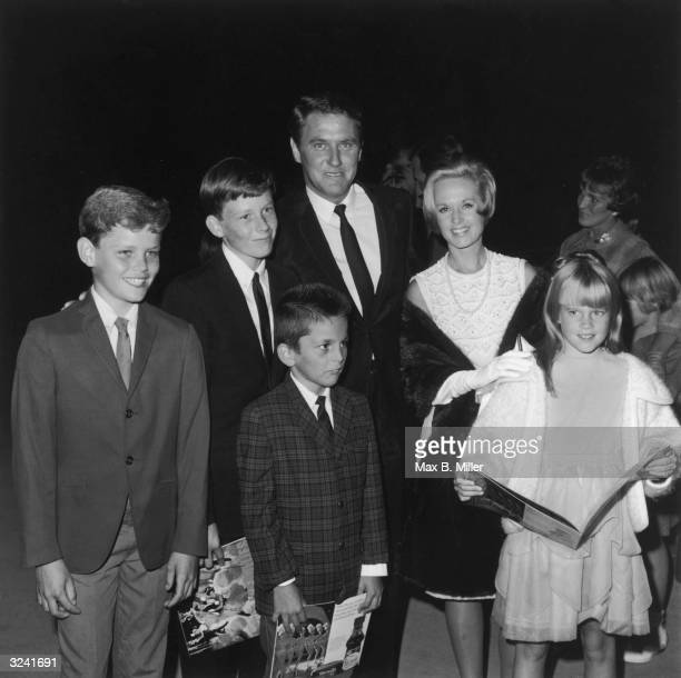 American actor Tippi Hedren stands with her husband the American movie producer Noel Marshall her daughter future American actor Melanie Griffith and...