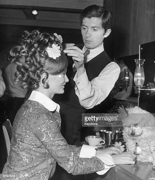 Monsieur Christophe of the famous Parisian house of Xirhodes at work in their first London salon in Bruton Street on a coiffure for actress Anna Palk...