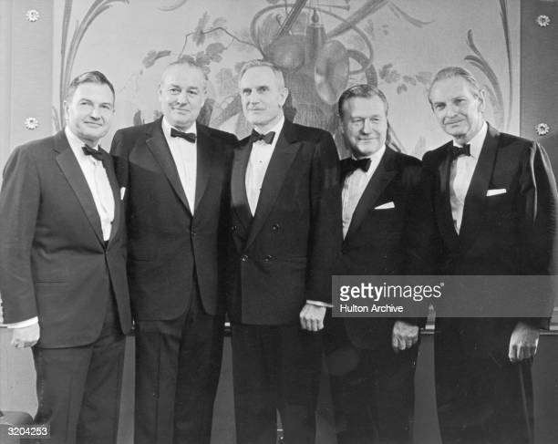 The five Rockefeller brothers posing together in front of a mural at an awards ceremony in New York during which each received a gold medal for...