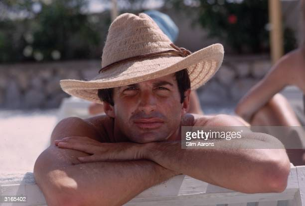 Actor George Hamilton works on his tan on the island of Capri.