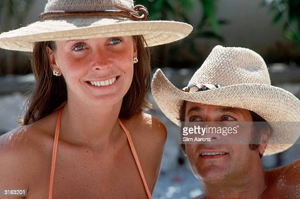 Film star Tony Curtis gazes at his third wife Leslie Allen while relaxing at the Quisisana Hotel Capri