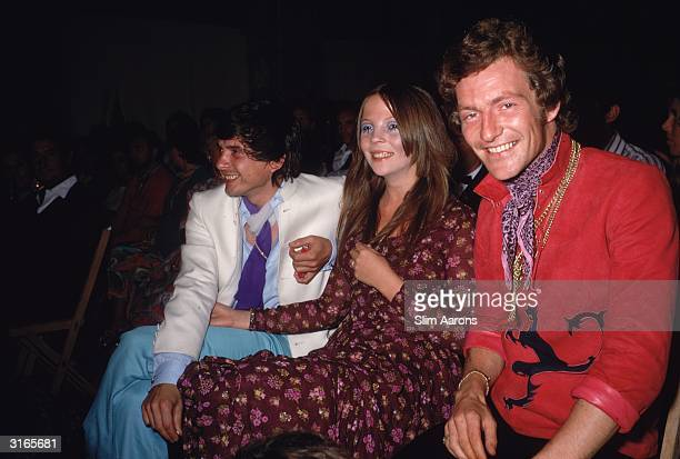 Photographers David Bailey and Patrick Earl of Lichfield sit on either side of model Penelope Tree in Capri