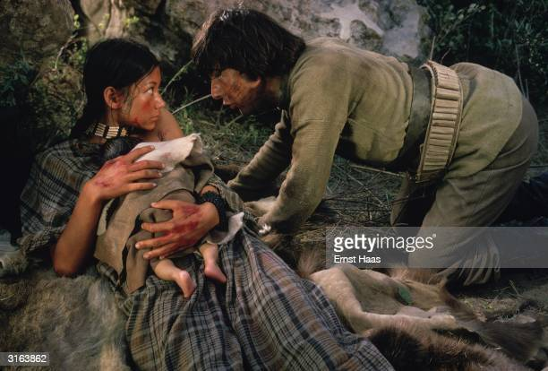 Dustin Hoffman finds a Native American girl played by Aimee Eccles giving birth to a baby in a scene from 'Little Big Man' directed by Arthur Penn