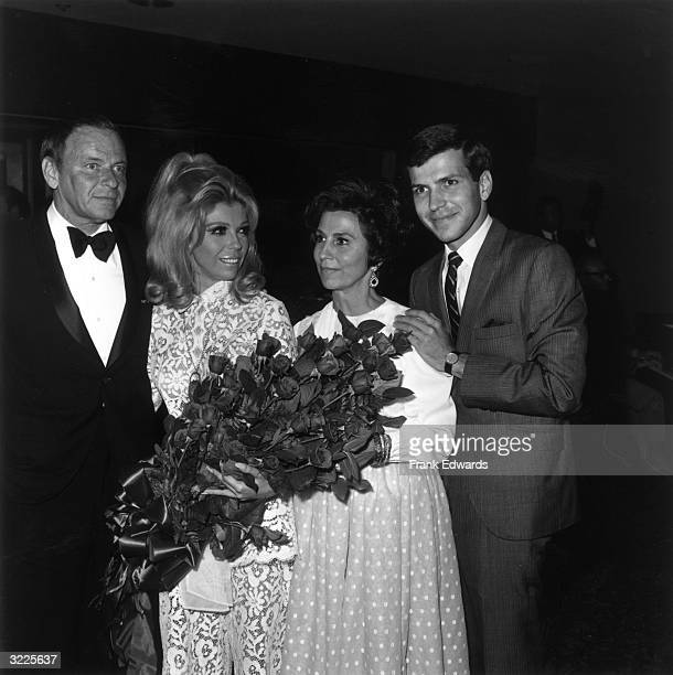 LR American singer and actor Frank Sinatra his daughter singer Nancy Sinatra his exwife Nancy Barbato and his son singer Frank Jr posing together on...