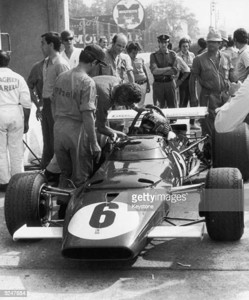 Italian racing driver Ignazio Giunti in his Ferrari 312B in the pits during the last practice for the Italian Grand Prix at Monza