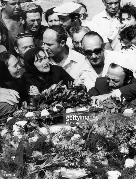 Israeli men and women weep over the coffins of eleven Israeli Olympic team members who were killed in a terrorist attack at the Munich Olympic Games...