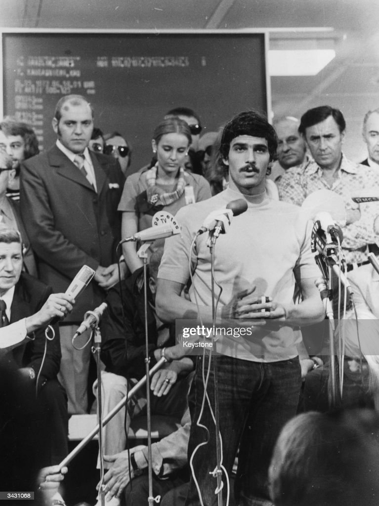Mark Spitz faces the press, after a medal presentation at the Olympic Games in Munich. He won seven gold medals for swimming in the Games.