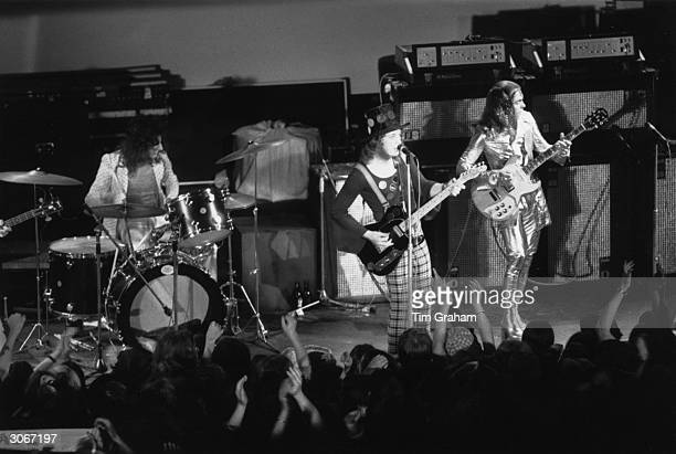 Pop group 'Slade' on stage at Mile End Odeon London L to r Don Powell on drums Noddy Holder and Dave Hill