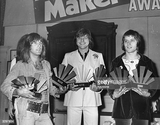Pop musicians Keith Emerson, Greg Lake and Carl Palmer, of the group Emerson Lake And Palmer - or ELP for short, receive their awards at the 1972...