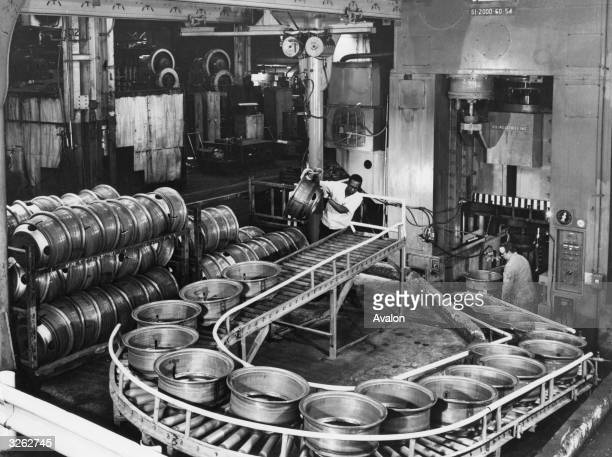Vehicle wheels on a conveyer belt in the American Budd Co subsidiary factory in Brazil