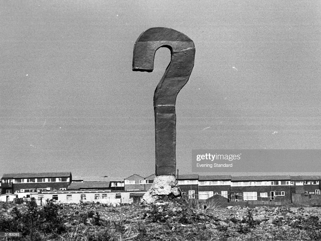 An upright piece of scrap metal and concrete forms a monumental question mark overlooking Milton Keynes, Buckinghamshire.