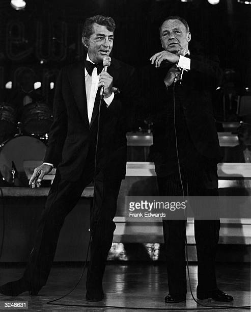 American actors and singers Dean Martin and Frank Sinatra perform onstage wearing tuxedos during the annual Jerry Lewis Muscular Dystrophy Telethon...