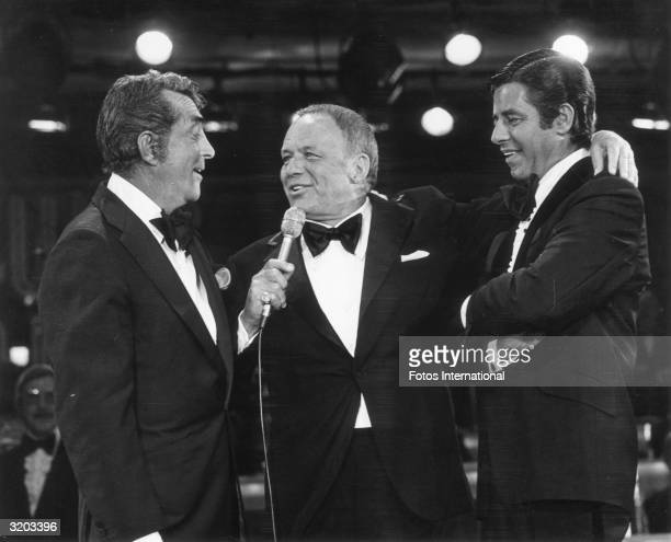 LR American actors and singers Dean Martin and Frank Sinatra and American actor and comedian Jerry Lewis perform on stage during the eleventh annual...