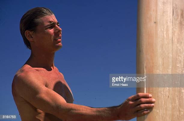 Actor Jan Michael Vincent and his surfboard on location in Hawaii for 'Big Wednesday' a film about Californian surfers in which he plays'Matt'