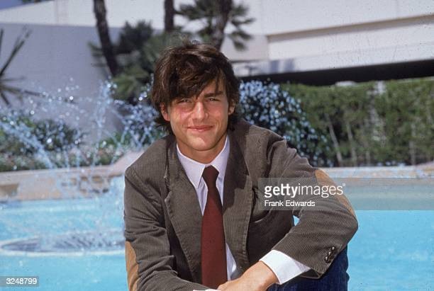 American actor Tom Cruise poses by a pool at the Beverly Hilton Hotel Beverly Hills California