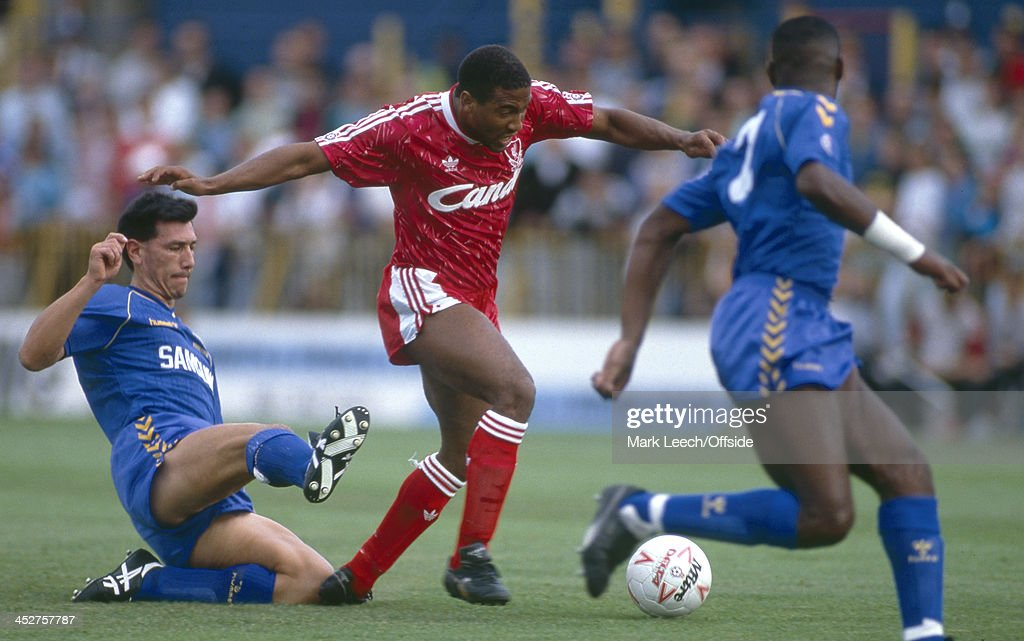 8 September 1990 - English Football League Division One - Wimbledon FC v Liverpool FC - Lawrie Sanchez of Wimbledon (left) goes in for a slide tackle on John Barnes of Liverpool (centre).