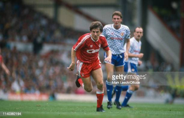 16 September 1990 Liverpool v Manchester United English Football Division One Liverpool Peter Beardsley of Liverpool rushes past an onlooking Steve...
