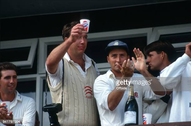 19 September 1991 Chelmsford County Cricket Championship Essex v Middlesex Derek Pringle raises a cup of Champagne alongside Nasser Hussein as Essex...