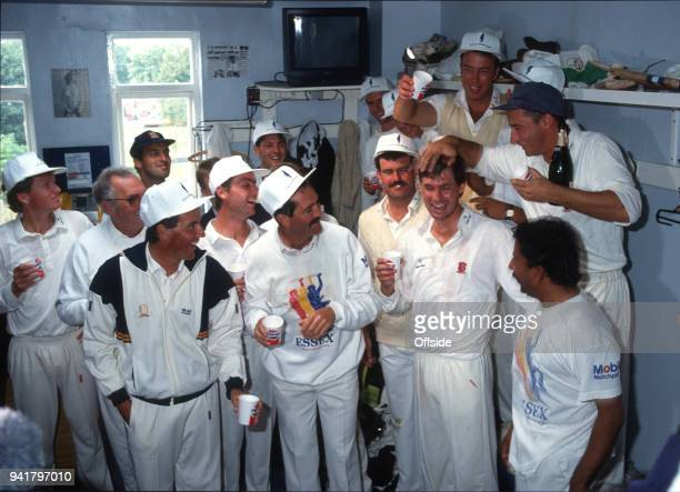 19 September 1991 Chelmsford County Cricket Championship Essex v Middlesex Derek Pringle and Nasser Hussein pour champagne over Neil Foster as Essex...