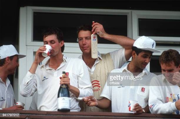 19 September 1991 Chelmsford County Cricket Championship Essex v Middlesex Derek Pringles holds a signed miniature bat as Essex celebrate winning the...