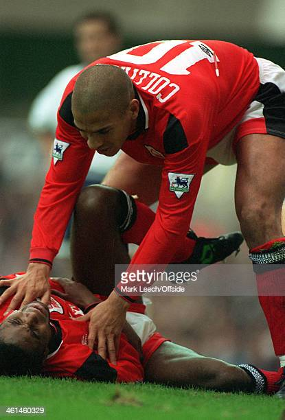 24 September 1994 FA Premiership Tottenham Hotspur v Nottingham Forest Stan Collymore checks on injured Forest colleague Bryan Roy